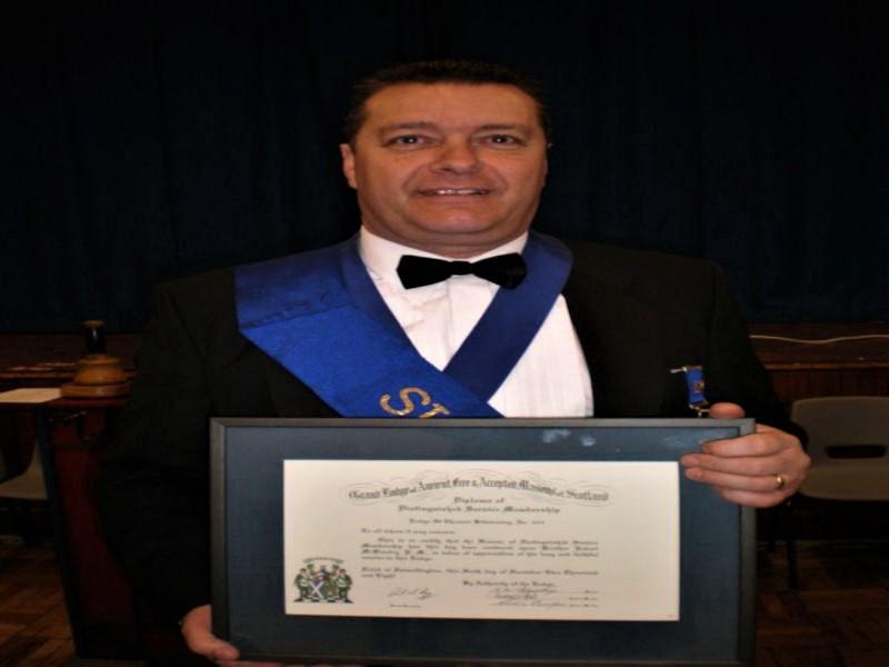 Presentation of Distinguished Service Diploma to Bro. Robert McKinstry
